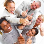 Laughing businesspeople showing thumbs up sign